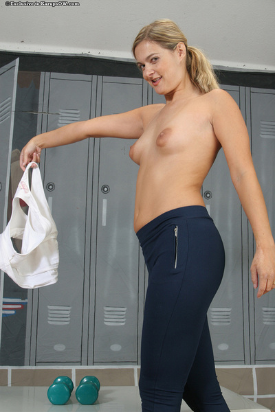 Sporty MILF undressing and oiling up her fuckable changes direction in the locker room