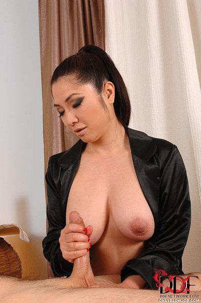 Boobsy Japanese masseuse Midori Tanaka delivering testicle licking dick sucking