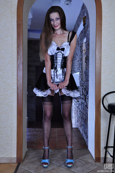 Upskirt French household slave discloses a duo of modish stockings tied to her corset