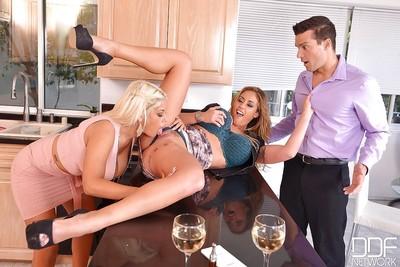 Latin hottie MILFs Bridgette B and Eva Notty take stream of cum on large pantoons in kitchen