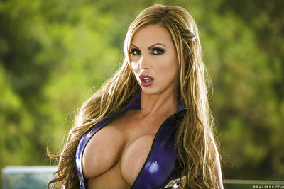 Titsy MILF in latex costume Nikki Benz striptease and expanding her legs