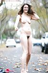Unbelievable brown hair angel Darya showing off her furry uterus outdoors