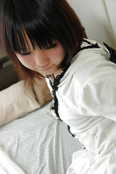 Eastern teen Chihiro Tanabe undressing and spreading her clits in close up