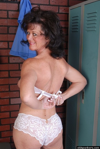 Naughty elderly Debella shows off her saggy tits in the changing room