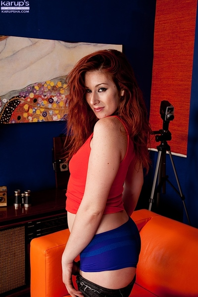 Sassy redhead amateur with ample a-hole undressing and spreading her legs
