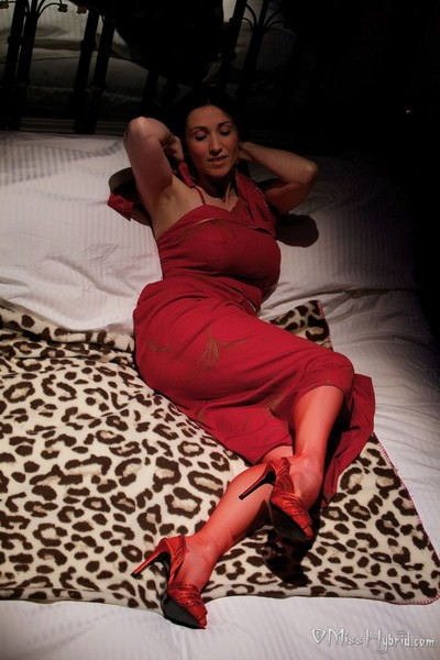 Red stockings and a mattress of petals