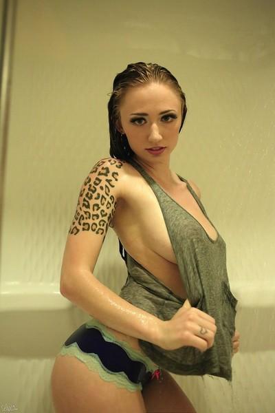 Showering busty girl