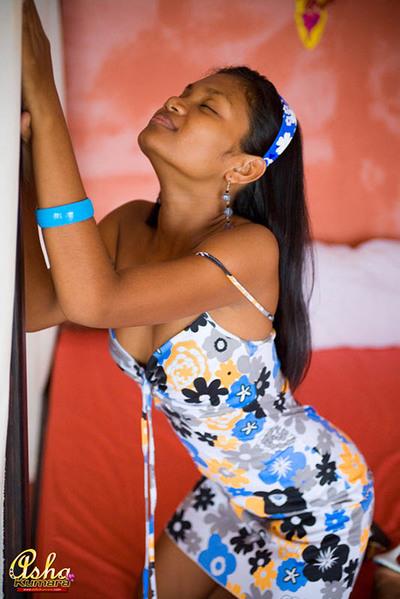 Indian cutie Asha Kumara poses in a charming girlfriend costume