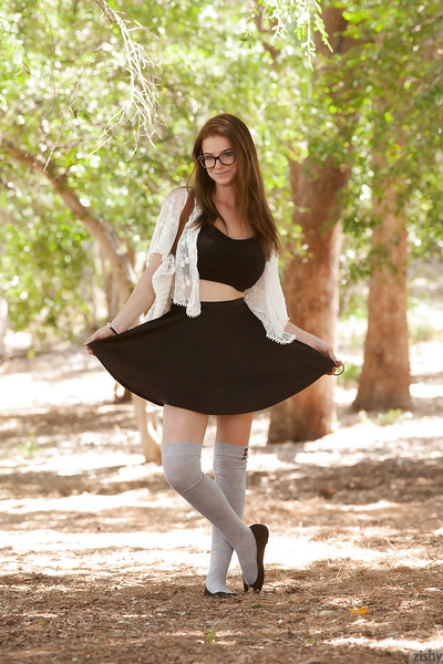 Fabulous brown hair adolescent Essie Halladay posing and flashing outside