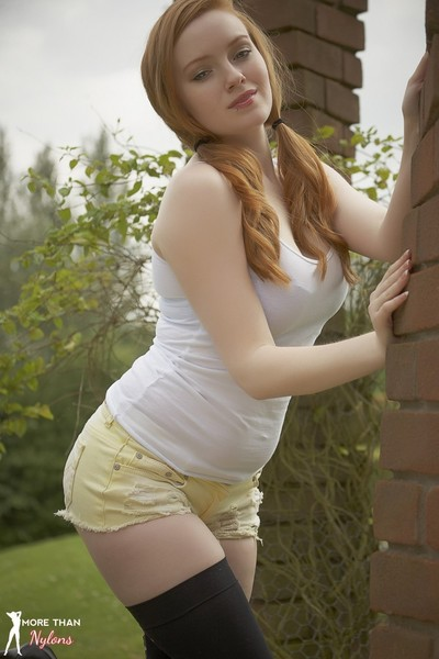 Hot redhead kloe outside in her holdup