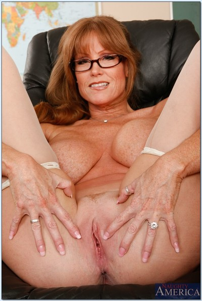 Grown educator in glasses Darla Crane stripping and amplifying her legs
