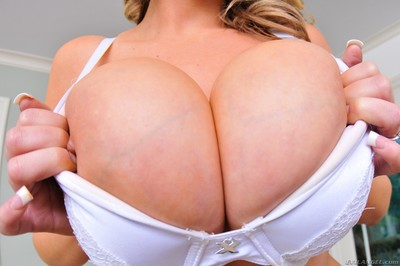 Katie kox puts a raw cock between her oiled up boobs