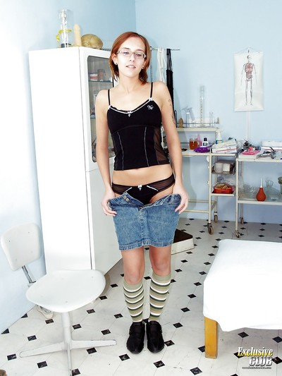 Elegant wiry babe Jane undressing for a gyno exam of her pussy