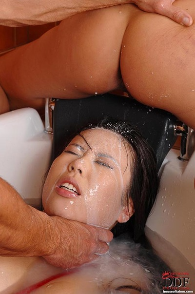 Nice-looking Kathia Nobili makes her Asian sub to suck cock in the bath