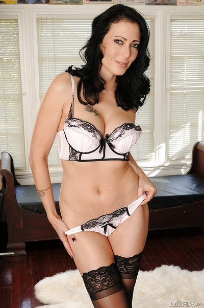 Elegant MILF Zoey Holloway erotic dancing off her costume and underclothes