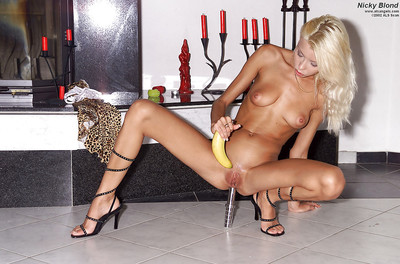 Tanned thin blonde Nicky Fairy stretching her sexy long legs
