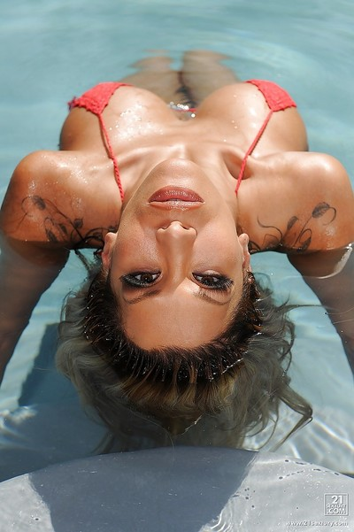 Naughty Latina chicito milf Kayla Carrera teases herself in the pool