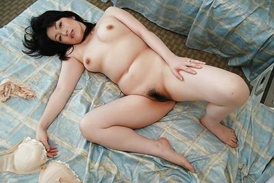 Chinese MILF Misuzu Masuko undressing and spreading her snatch lips in close up