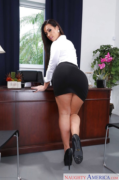 Brunette office queen Kelsi Monroe showing off phat secretary ass in office