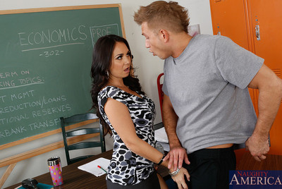 Holly West fucks a student on her desk during no one else is around.