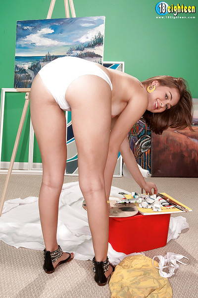 Cute teen Paige Riley strips and shows nice ass in a painting class