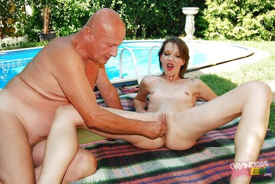 Kinky babe licks an oldman