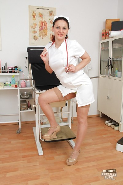 Vast busted placid nurse in nylons exposing and toying her juicy gash
