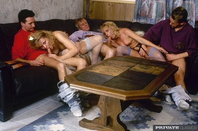 Dual retro babes in fur coats and colored stockings team fucking