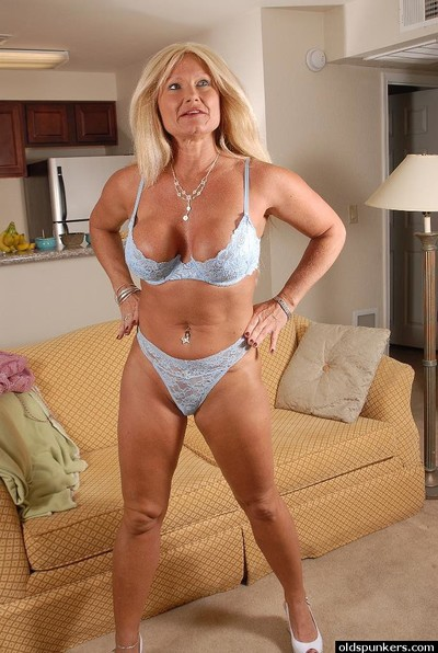 Granny blonde Roxy is demonstrating her undressed pussy and boobies