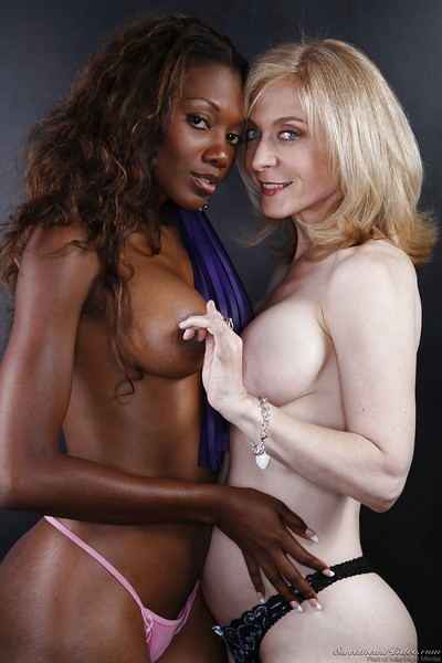 Mature blonde lesbo has some fun with her pretty ebony supporter