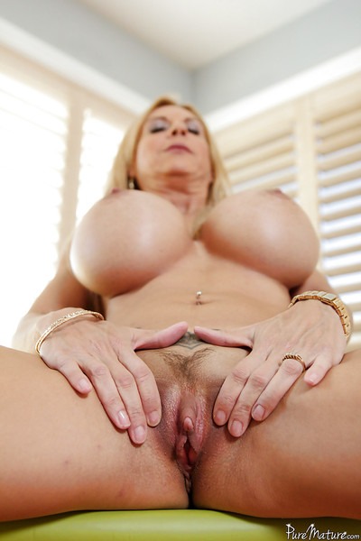 Big tit mature woman Brooke Tyler posing in high heels and jeans