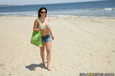 Sexy Charisma Cappelli in glasses in bikini shows her body outdoor