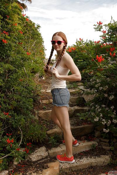 Pigtail wearing redhead teen Wendy Patton having fun exposing she