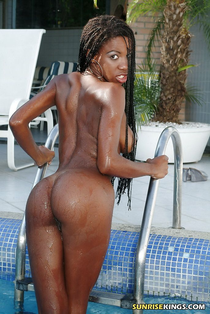 African pornstar Aline showing off tense round apple bottoms in the pool