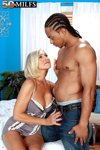 Hot older blond Katia takes a big ebony cock in all of willing holes