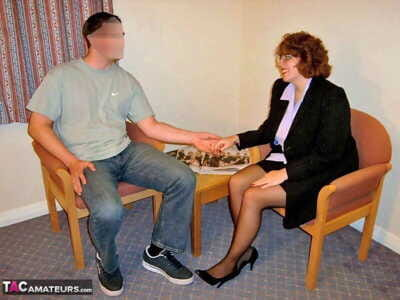 Fat seasoned escort with hairy red hair entertains a stallion in a motel room