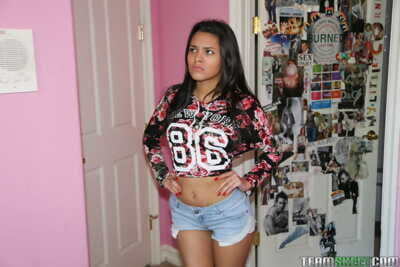 Perky titted Latina infant Josie Jagger takes off her bra and removes clothes