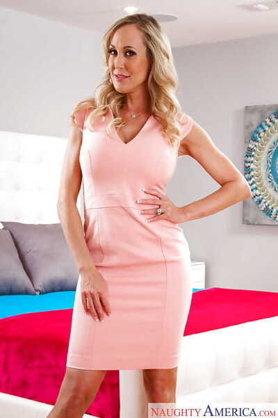 Curvy fairy-haired babe Brandi Love releases big MILF pornstar mambos from underware