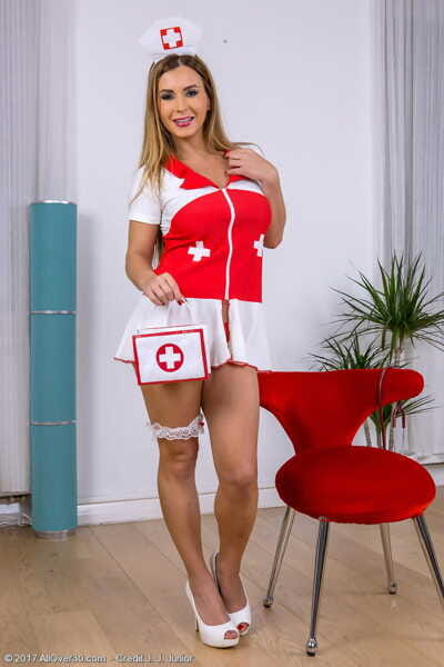 Blonde nurse Dorothy Black reveals her large tits as she works burst of uniform