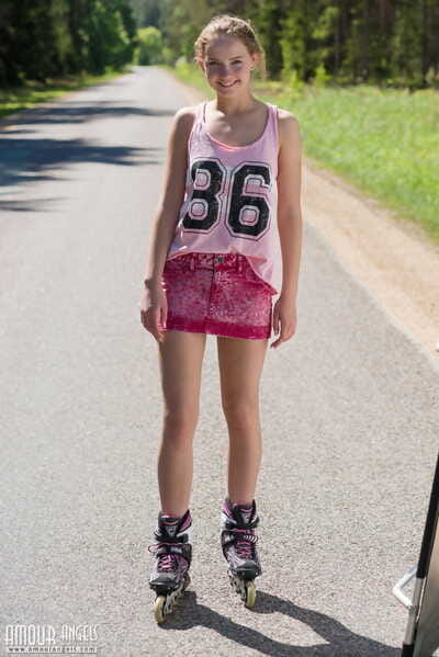 Teen blonde girl Faina gets naked in middle of road wearing roller blades