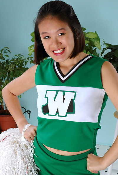Amateur Oriental freeing big tits and ass from beneath cheerleader uniform