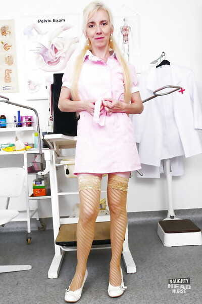 Aged nurse shedding uniform before spreading hairy cooter in stockings