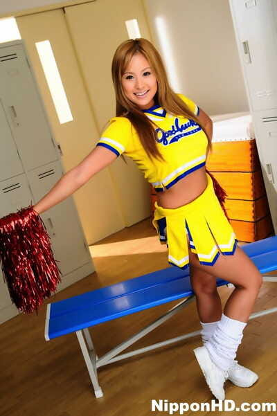 Adorable Japanese cheerleader uncovers great tits ahead of showing her pussy