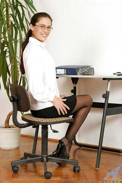 Classy babe Linda Brown showing off her stockings at the office.