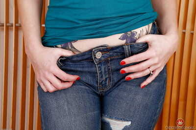 Dark haired solo girl Veruca James shedding ripped jeans to expose beaver