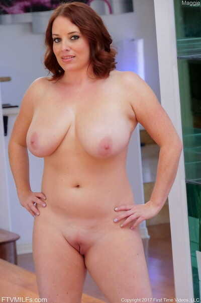 Bulky mom Maggie oils her belly- big boobs- and perfectly shiny on top slit