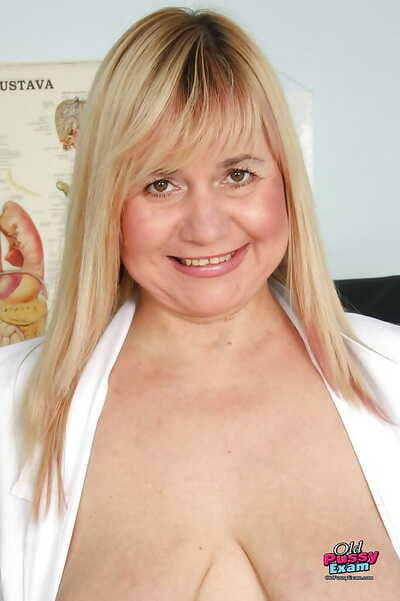 Fatty mature gyno nurse in black stockings having enjoyment with her toys