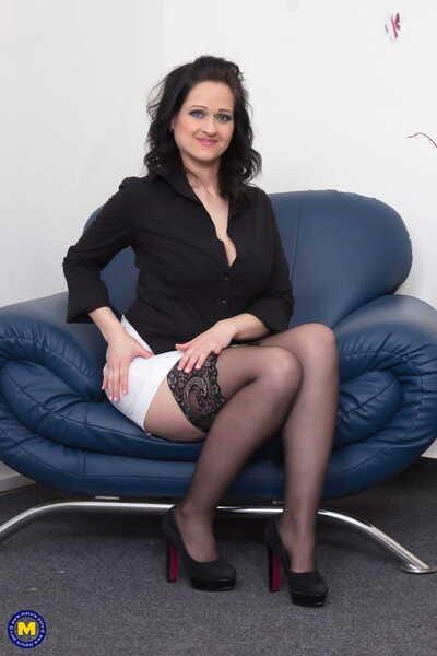 Massive boobed MILF Dominika S toys her mature vagina in black stockings