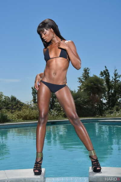 Fit ebony chick Ana Foxxx shows her perfect ass after doffing a bikini by pool