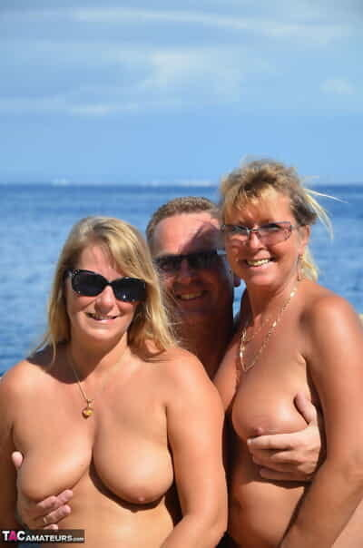 Two blonde women with saggy mambos enjoy hot suck and fuck in beach two men plus one female